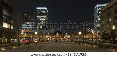 Tokyo Station main entrance avenue with skyscrapers at night, Japan