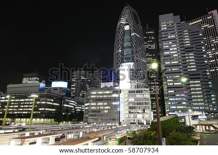 Tokyo streets, bus station and skyscrapers at night from high above - stock photo