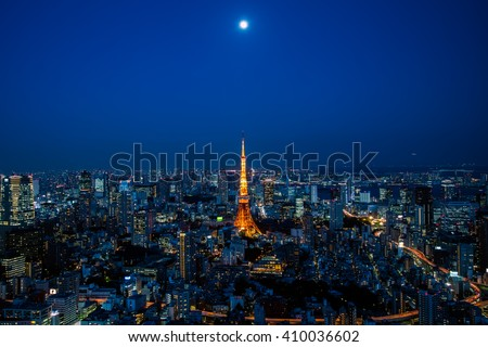 Tokyo Tower and the Moon above - stock photo