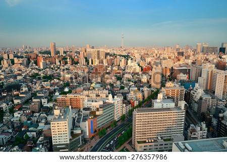 Tokyo urban skyline rooftop sunset view, Japan. - stock photo