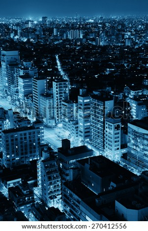 Tokyo urban skyscraper skyline rooftop view at night, Japan. - stock photo
