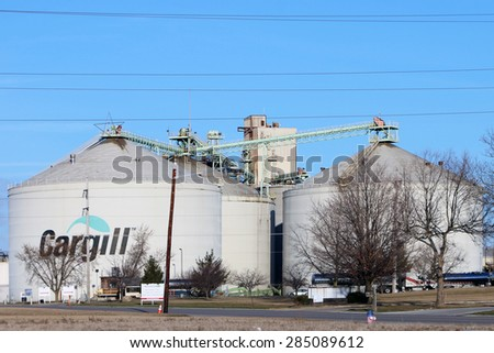 TOLEDO, OH-MAY, 2015:  Large grain agricultural silos owned by Cargill, the largest privately owned corporation in the United States.  Cargill employs over 150,000 people.   - stock photo