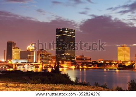 Toledo, Ohio - downtown over Maumee River at sunset - stock photo
