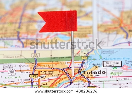 Toledo, Ohio. Red flag pin on an old map showing travel destination. - stock photo