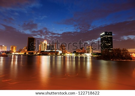 Toledo, Ohio - sunset seen accross Maumee River. - stock photo