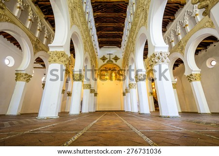 TOLEDO, SPAIN - NOVEMBER 11, 2014: Santa Maria La Blanca Church. Originally known as the Ibn Shushan Synagogue, it is disputably considered the oldest synagogue building in Europe still standing. - stock photo