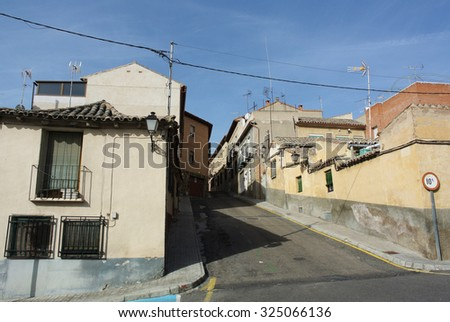 TOLEDO, SPAIN - OCTOBER 20, 2014: A photograph of one of many streets and medieval buildings in the old city of Toledo, Spain, Oct.20, 2014.