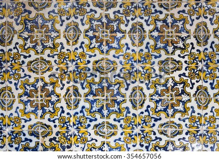 TOLEDO, SPAIN - SEPTEMBER 6 2015: Detail of a 17th century polychrome Panel of Portuguese Tiles in the Museum of Santa Cruz, on September 6, 2015, in Toledo, Spain - stock photo