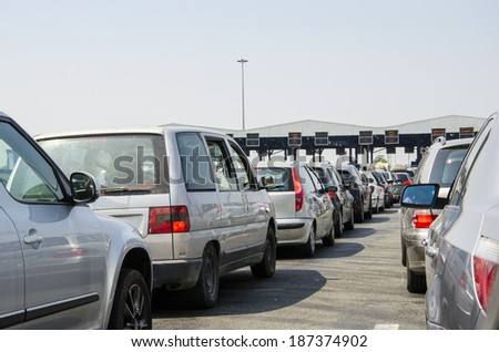 Toll collecting causing massive traffic congestion during rush hours. - stock photo