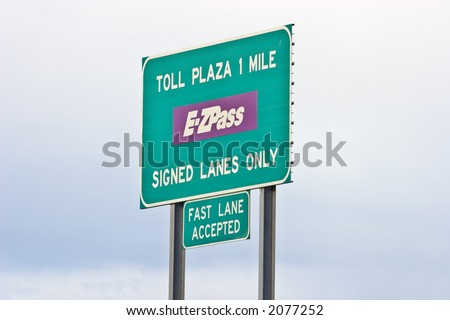 Toll road sign telling of upcoming toll booth plaza - stock photo