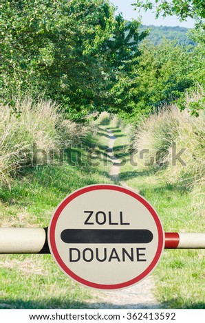 Tollgate with demarcation and road sign customs office between two countries. - stock photo