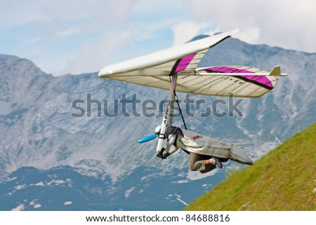 TOLMIN, SLOVENIA - AUGUST 20: Competitor  takes part in the Kobala Open-2011 hang gliding competitions on August 20, 2011 near Tolmin, Slovenia.