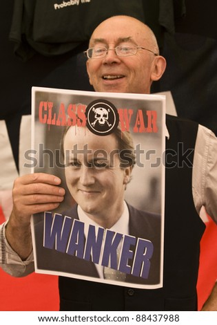 TOLPUDDLE - JULY 17: Class War activist holds up a poster about British Prime Minister David Cameron at the Tolpuddle Martyrs Festival  on July 17, 2010 in Tolpuddle, Dorset. - stock photo