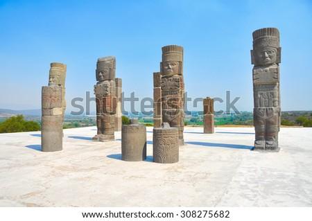 Toltec Warriors - Atlantes - columns topping the Pyramid of Quetzalcoatl in Ancient ruins of Tula de Allende - archaeological site in Hidalgo, Mexico - stock photo