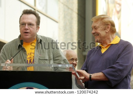 Tom Arnold and Jerry Buss at the Ceremony Honoring Los Angeles Lakers Owner Jerry Buss with the 2,323rd star on the Hollywood Walk of Fame. Hollywood Boulevard, Hollywood, CA. 10-30-06 - stock photo