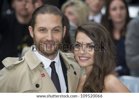 """Tom Hardy and Charlotte Riley arriving for European premiere of """"The Dark Knight Rises"""" at the Odeon Leicester Square, London. 18/07/2012 Picture by: Simon Burchell / Featureflash - stock photo"""