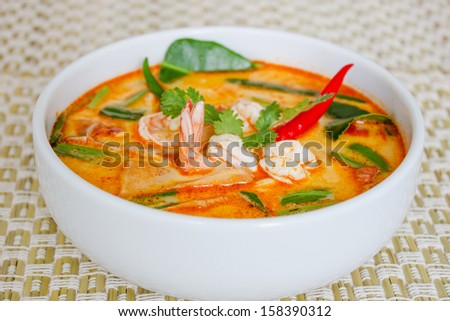 Tom yam kong or Tom yum, Tom yam is a spicy clear soup typical in Thailand and No.1 Thai Dish Cuisine. - stock photo