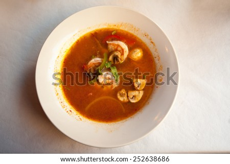 Tom yam kung soup in Thai restaurant - stock photo