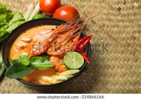 Tom Yum Goong spicy soup with ingredient traditional thai food cuisine in Thailand on mat wicker background  - stock photo