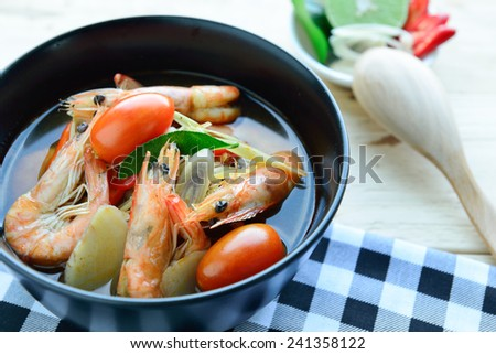 Tom Yum Goong - Thai hot and spicy soup seafood with shrimp - Thai Cuisine - stock photo