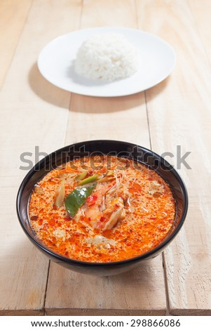 Tom Yum soup with Jasmine Rice on wooden table,thai food - stock photo