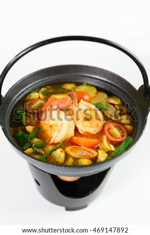 Tom Yum with shrimp. Spicy soup with shrimp in a hot pot, Thai cuisine