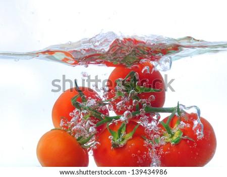 tomat drop, studio shot - stock photo