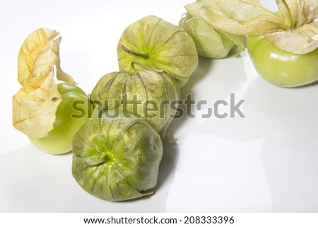 Tomatillos on a white bckground