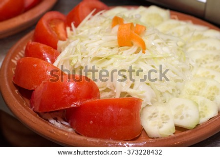 Tomato and cabbage salad on the plate. - stock photo