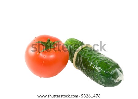 tomato and cucumber in a condom isolated on white