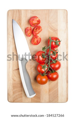 Tomato and knife on a cutting board, isolated - stock photo