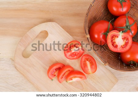 Tomato and sliced tomato prepare on the wood board and for tomato juice