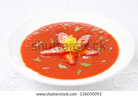 tomato and strawberry gazpacho in a plate, horizontal - stock photo