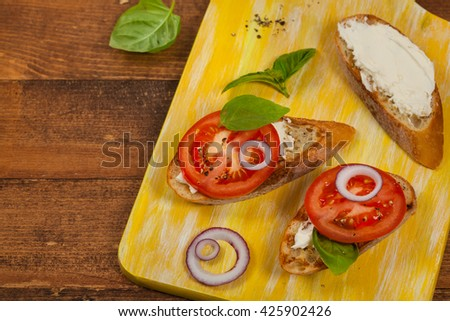 Tomato, Basil and Cream Cheese Sandwich. Selective focus. - stock photo