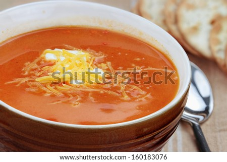 Tomato Bisque with sour cream and cheddar cheese.