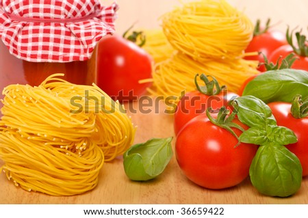 Tomato bolognaise sauce with pasta and basil herbs - stock photo