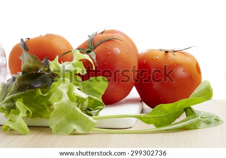 Tomato, close up fresh tomatoes on the cut plate. - stock photo
