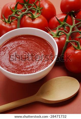 Tomato cream and spoon.  Creamed tomatoes sauce. - stock photo