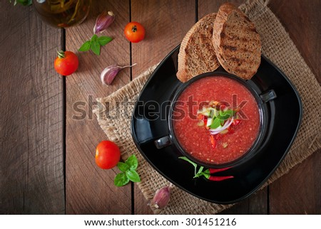 Tomato gazpacho soup with pepper and garlic. Top view - stock photo