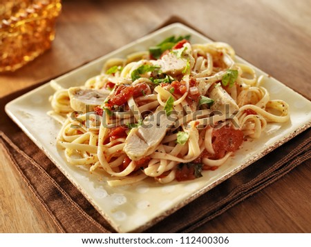 tomato herb linguine with grilled chicken slices - stock photo