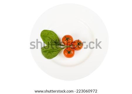 Tomato on plate.Isolated on white background - stock photo