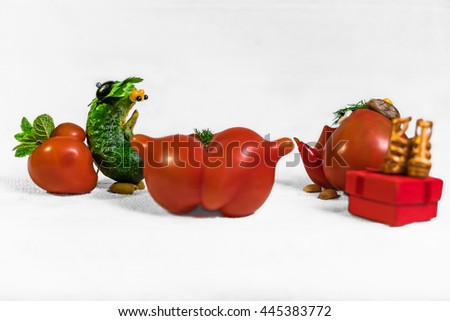 Tomato people on bright white cloth.Vegetables date.Tomato valentines day - stock photo