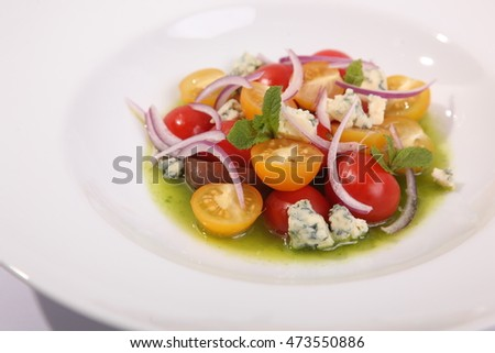 tomato salad and Dor blue cheese on plate