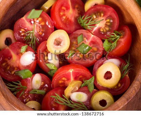 Tomato salad with onion and olives - stock photo