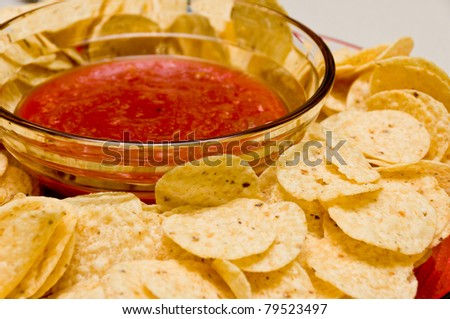 Tomato Salsa and Tortilla Chips on a plate - stock photo