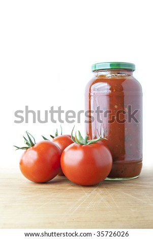 Tomato Sauce and Ripe Tomatoes on Wood