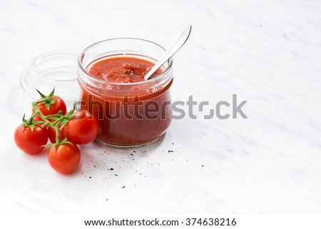 tomato sauce in a glass jar, horizontal - stock photo