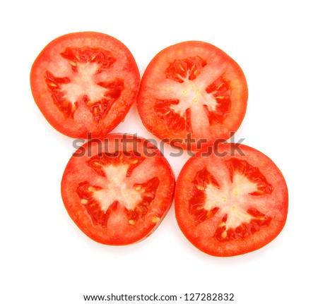 Tomato slices over a white background - stock photo