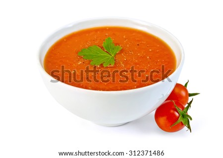 Tomato soup in a white bowl with parsley and tomatoes isolated on white background - stock photo