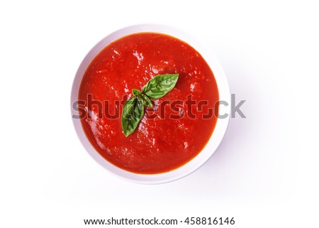 tomato soup in white bowl isolated on white background